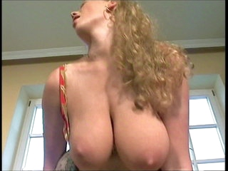 Teen beauty with massive natural titties